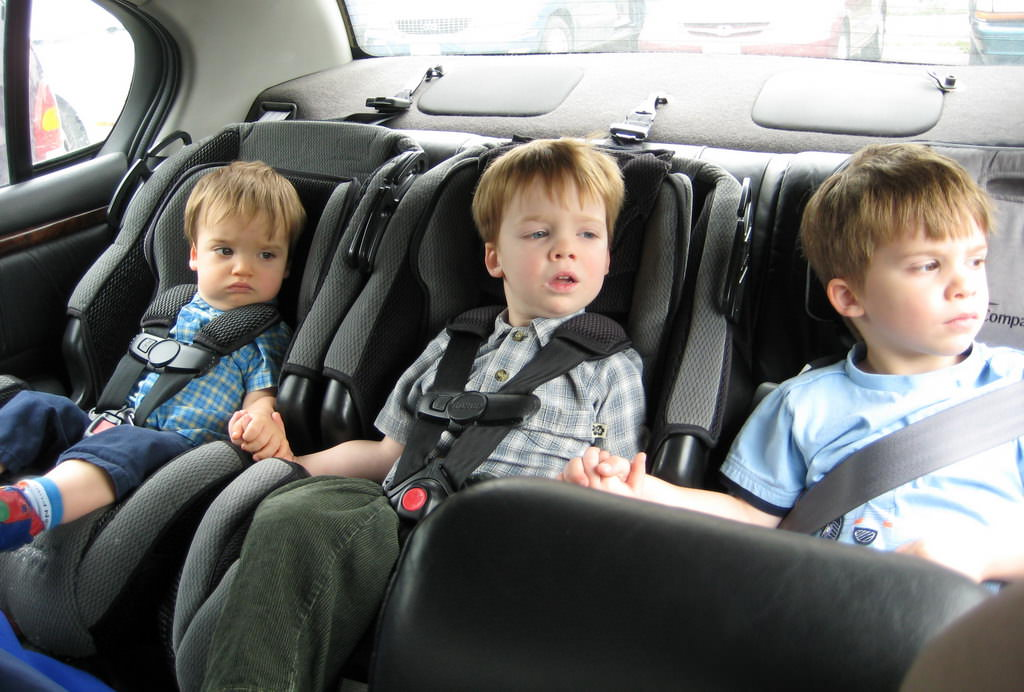 3 children in  car seat